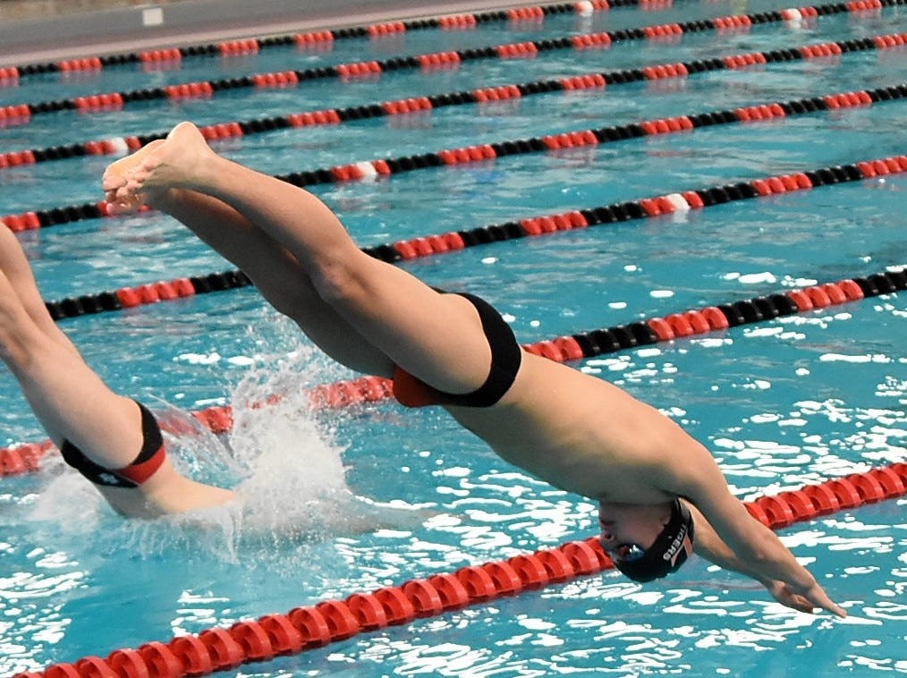 Loveland's Trey Stutz looks to touch the water as he swims the boys 50 freestyle at the Southwest Ohio Swimming and Diving Classic, January 19, 2019.