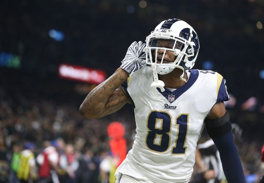 Los Angeles Rams tight end Gerald Everett (81) reacts after a Rams touchdown against the New Orleans Saints during the third quarter of the NFC Championship game at Mercedes-Benz Superdome.