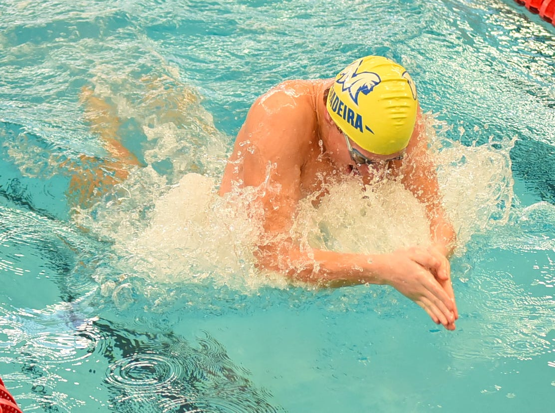 Madeira's Logan Kaising heads back under water in the final heat of the boys 50 breaststroke in the preliminaries at the Southwest Ohio Swimming and Diving Classic, January 19, 2019.