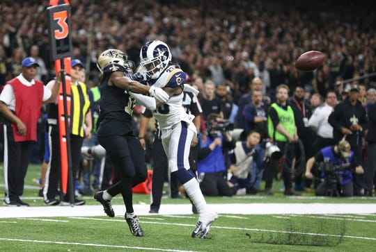 Los Angeles Rams defensive back Nickell Robey-Coleman (23) breaks up a pass intended or New Orleans Saints wide receiver Tommylee Lewis (11) during the fourth quarter of the NFC Championship game at Mercedes-Benz Superdome.