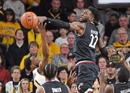 Cincinnati Bearcats forward Eliel Nsoseme (22) blocks the shot attempt of Wichita State Shockers forward Markis McDuffie (1) during the second half at Charles Koch Arena.