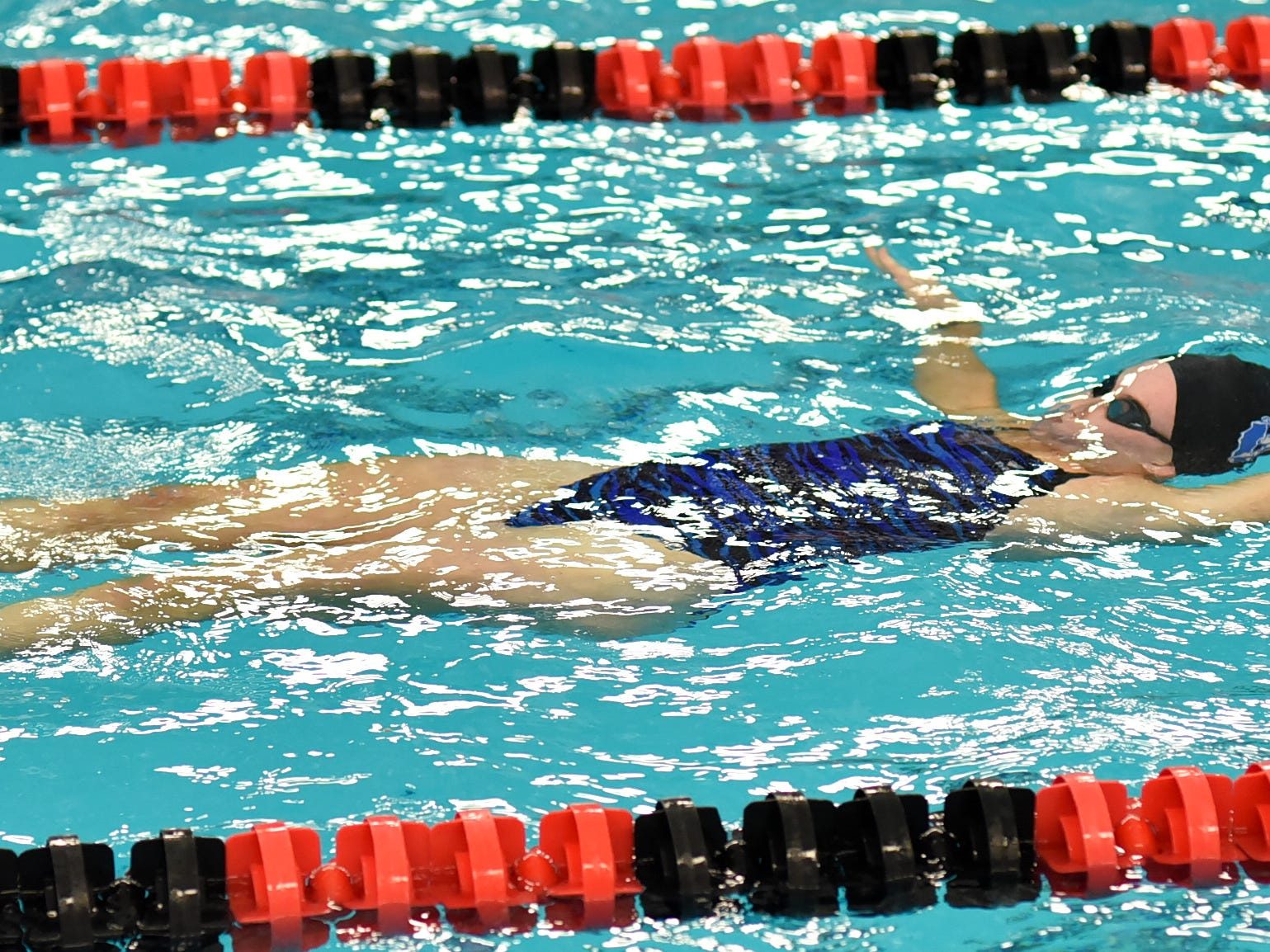 Grace Anderson of Summit Country Day comes up from treading water to power out the backstroke at the Southwest Ohio Swimming and Diving Classic, January 19, 2019.
