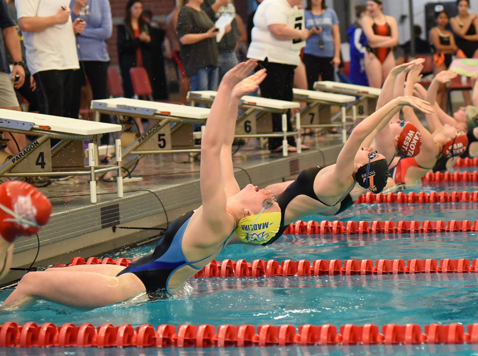 The final heat of the girls 100 backstroke is underway in the preliminaries at Princeton for the Southwest Ohio Swimming and Diving Classic, January 19, 2019.