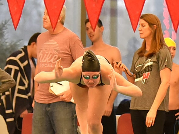 Lauren Williams of Loveland is ready on her mark for the final heat of the girls 100 IM at the Southwest Ohio Swimming and Diving Classic, January 19, 2019.