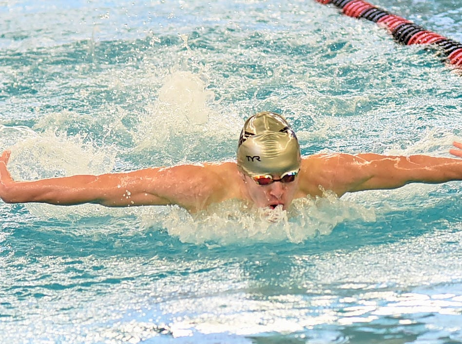 Alexander Devine of Lakota East swims in heat two of the boys 100 butterfly at the Southwest Ohio Swimming and Diving Classic, January 19, 2019.