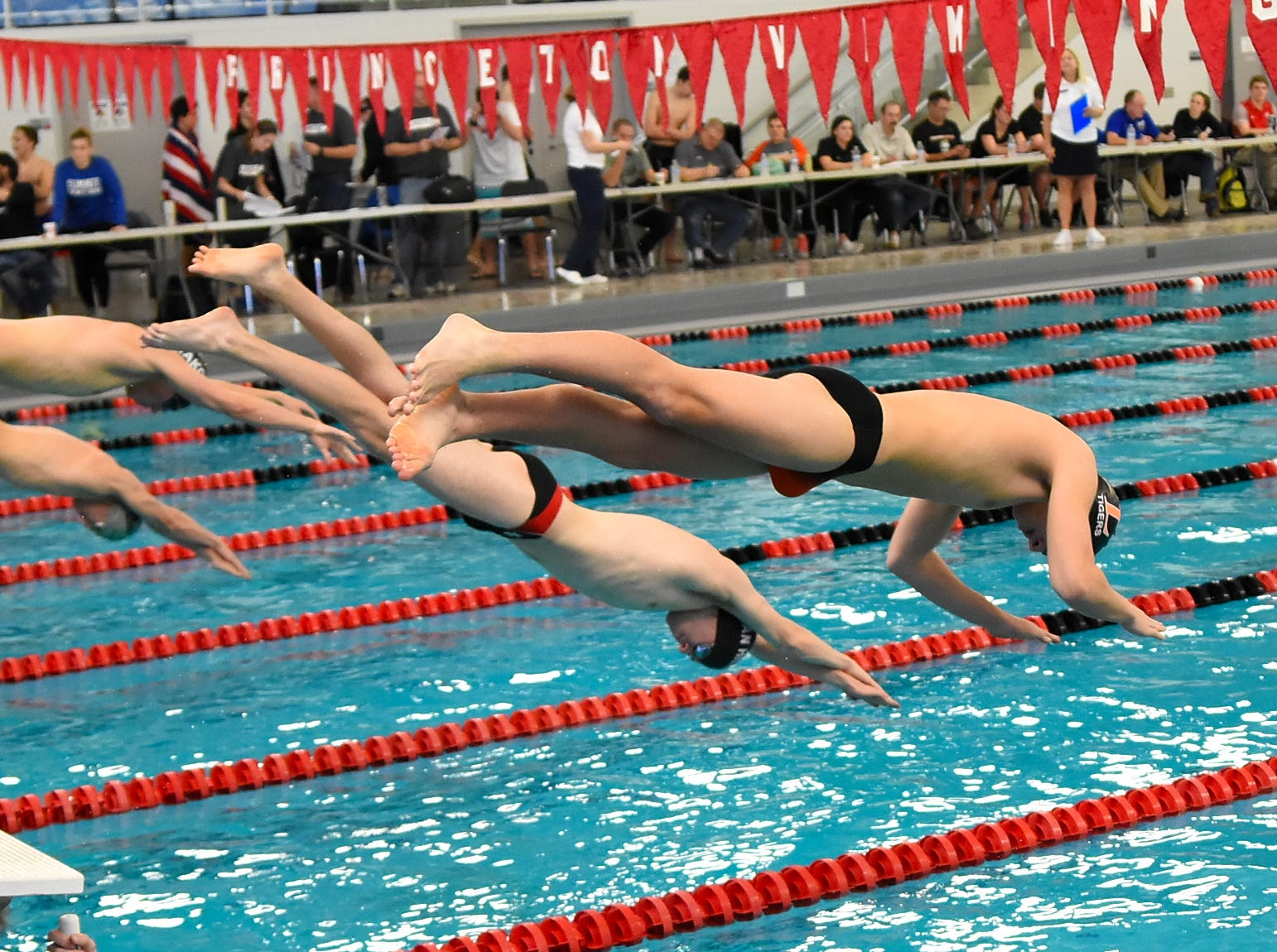 Swimmers hit the pool in the boys 50 freestyle at the Southwest Ohio Swimming and Diving Classic, January 19, 2019.