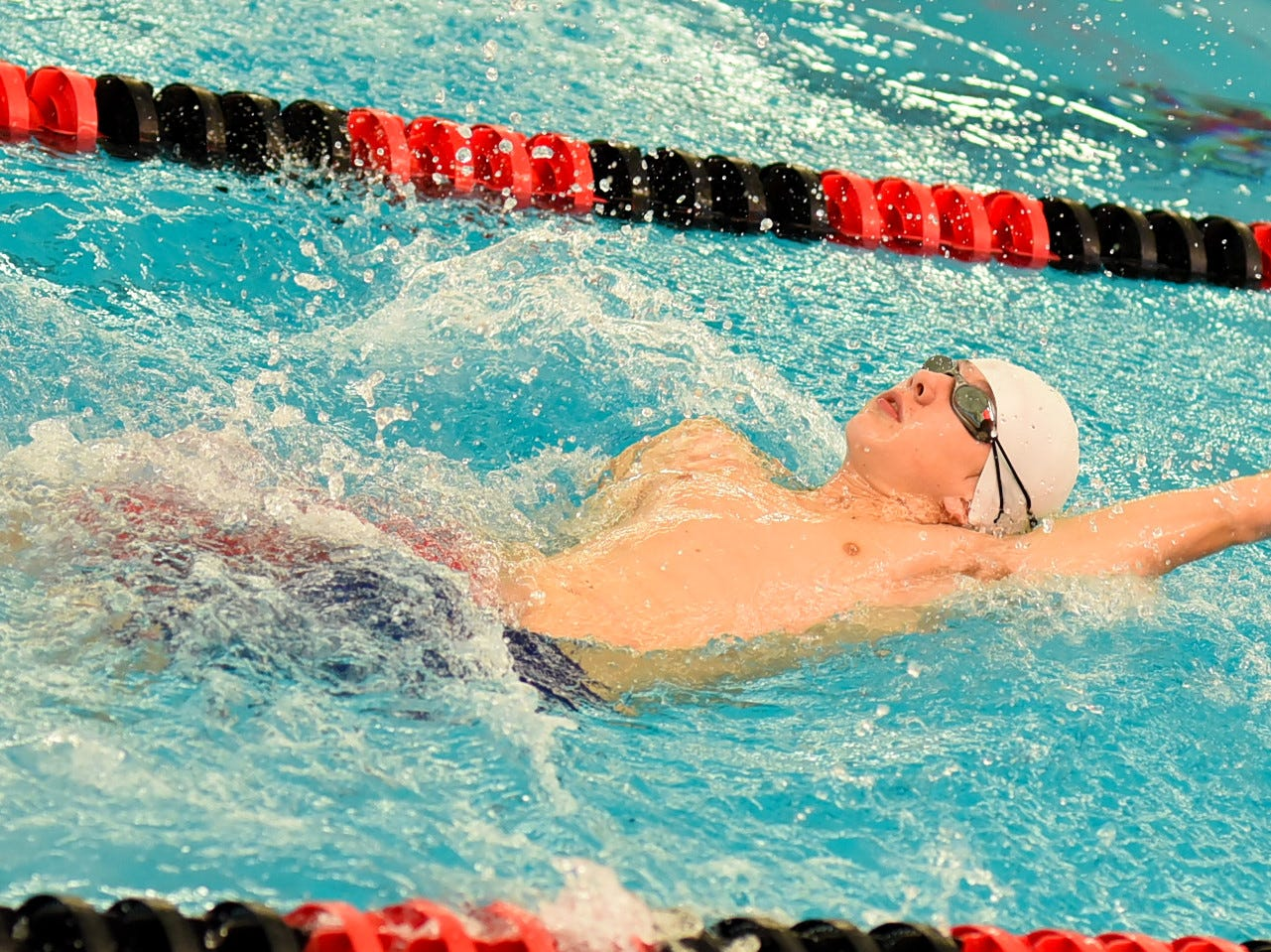 Conner Barners of Norwood swims in the boys 100 backstroke preliminaries at the Southwest Ohio Swimming and Diving Classic, January 19, 2019.