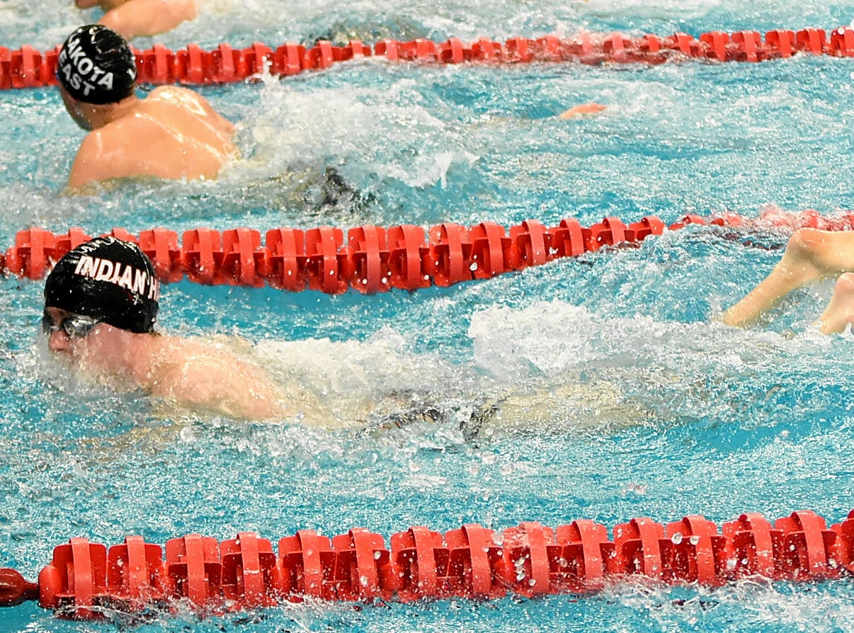 Owen Norwell touches the finish mark in the ninth heat of the boys 50 freestyle at the Southwest Ohio Swimming and Diving Classic, January 19, 2019.