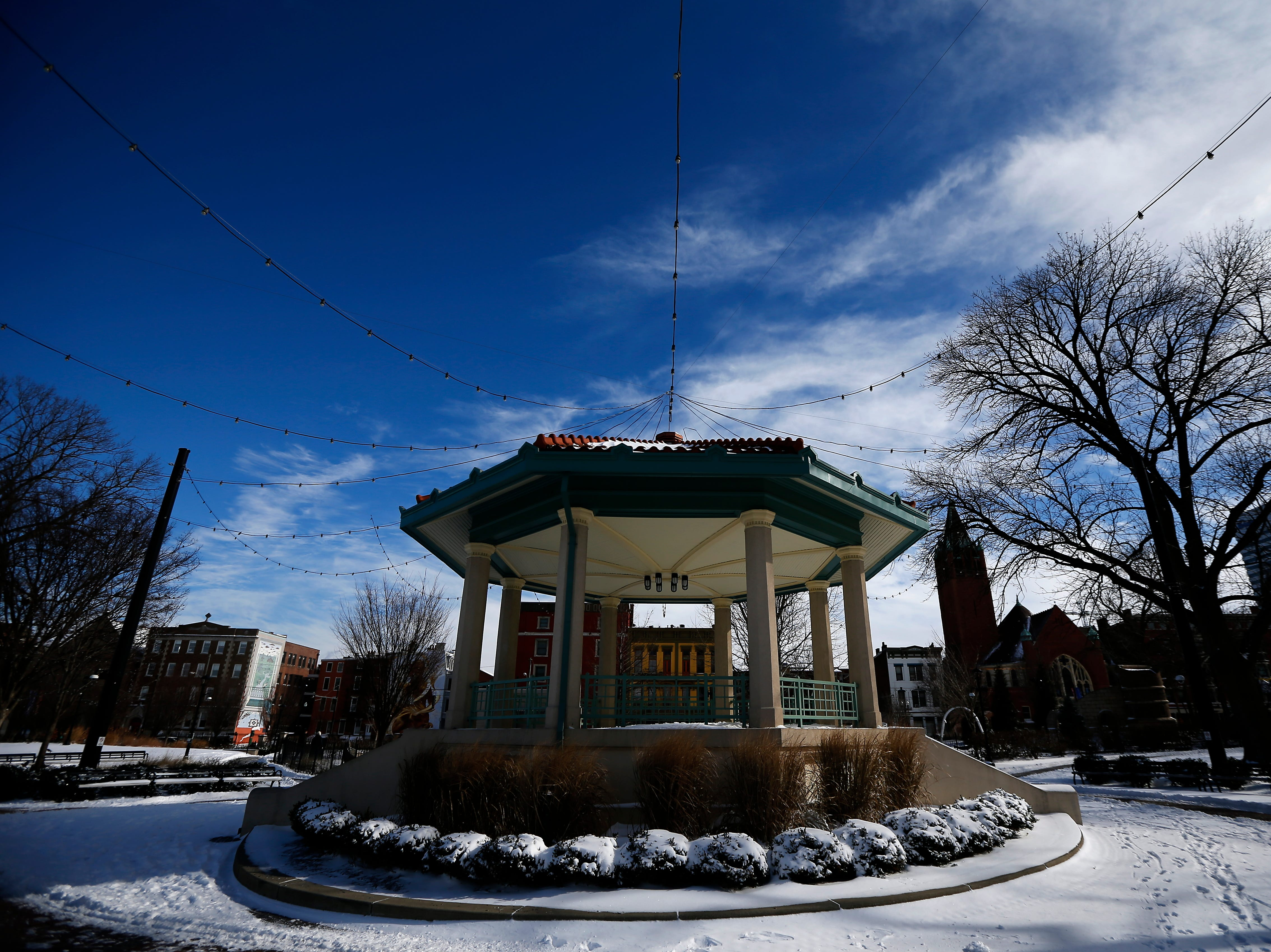 The gazebo is covered in snow at Washington Park in the Over-the-Rhine neighborhood of Cincinnati on Sunday, Jan. 20, 2019. Temperatures remain below 15 degrees with windchills as low as 4 in the region Sunday.