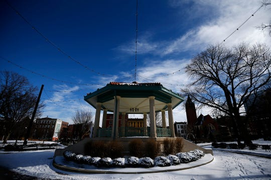 The gazebo is covered in snow at Washington Park in the Over-the-Rhine neighborhood of Cincinnati on Sunday.