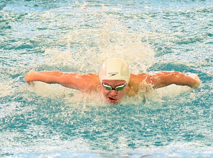 William Ford of Indian Hill eyes the finish line in the boys 100 butterfly at the Southwest Ohio Swimming and Diving Classic, January 19, 2019.