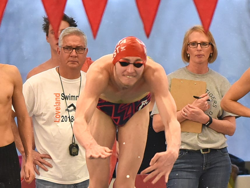 Zachary Suarine of Lakota West dives into the pool for the final leg in the final heat of the boys 400 medley at the Southwest Ohio Swimming and Diving Classic, January 19, 2019.
