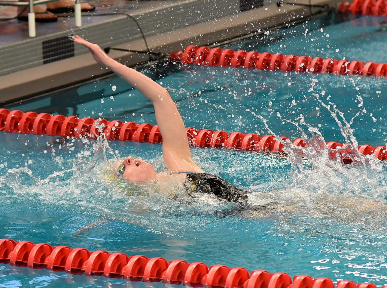 Emma Fortman of Madeira finished the last stroke of the girls 100 backstroke preliminaries in first place at the Southwest Ohio Swimming and Diving Classic, January 19, 2019.