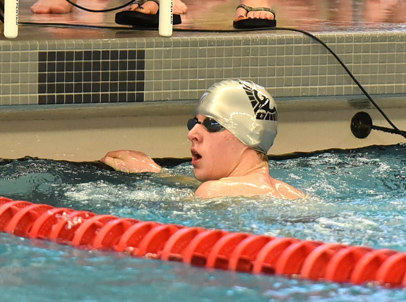 Evan Devine closes out the boys 400 medley for Lakota East at the Southwest Ohio Swimming and Diving Classic, January 19, 2019.