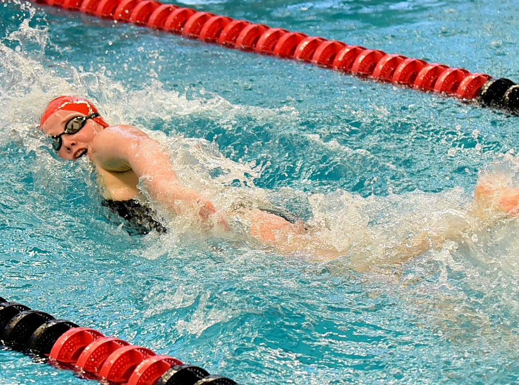 Reagan Manning of Lakota West heads to the finish in the girls 50 freestyle at the Southwest Ohio Swimming and Diving Classic, January 19, 2019.