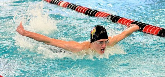 Asheton Hannah of Princeton swims in the 100 Butterfly during the preliminaries at the Southwest Ohio Swimming and Diving Classic, January 19, 2019.