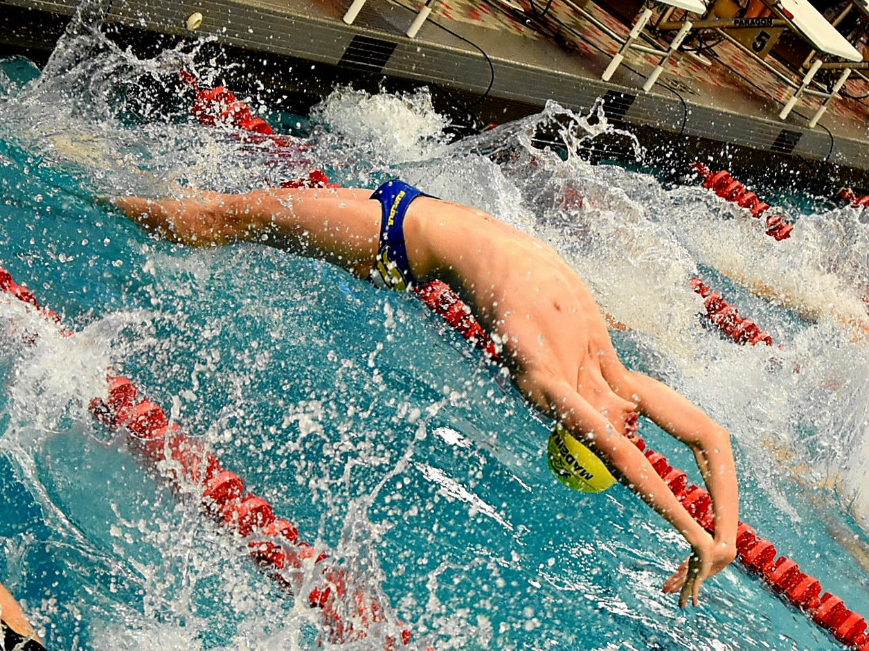 David Stevenson of Madeira pushes off in the third heat of the boys 400 medley at the Southwest Ohio Swimming and Diving Classic, January 19, 2019.
