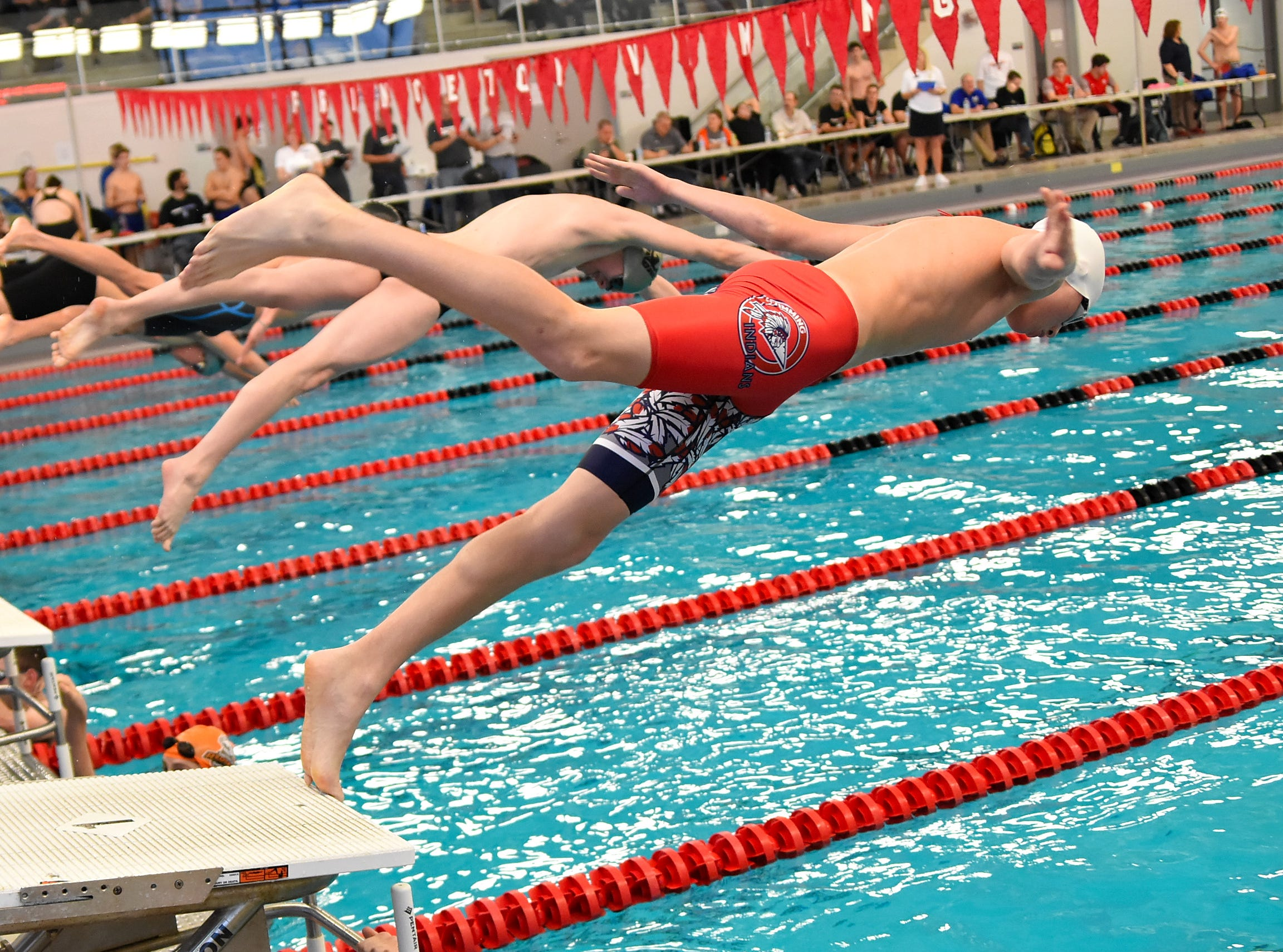 Elijah Partin of Norwood pushes off the platform to the pool in the boys 50 freestyle at the Southwest Ohio Swimming and Diving Classic, January 19, 2019.