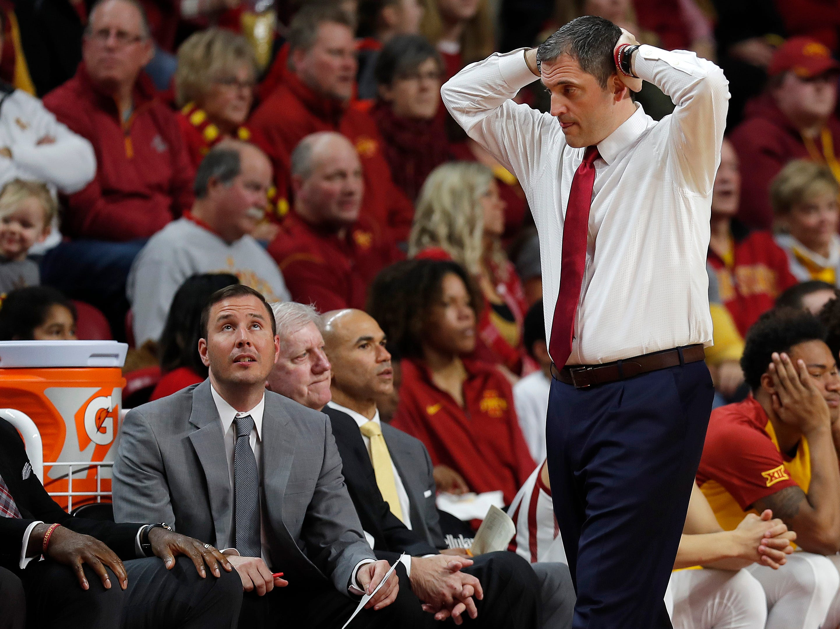 Iowa State oach Steve Prohm, right, reacts after a foul on Iowa State during the first half of an NCAA college basketball game against Oklahoma State, Saturday, Jan. 19, 2019, in Ames.