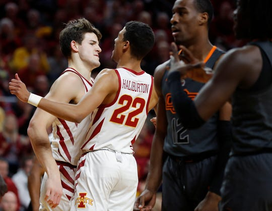 Iowa State forward Michael Jacobson, left, bumps chest with Iowa State guard Tyrese Haliburton, center, after Jacobson was fouled on a shot during the first half of an NCAA college basketball game against Oklahoma State, Saturday, Jan. 19, 2019, in Ames.
