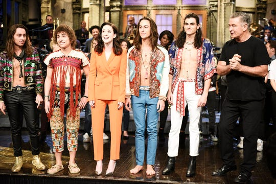"Musical guest Greta Van Fleet, host Rachel Brosnahan, and Alec Baldwin stand on stage after ""Saturday Night Live"" on Jan. 19, 2019."