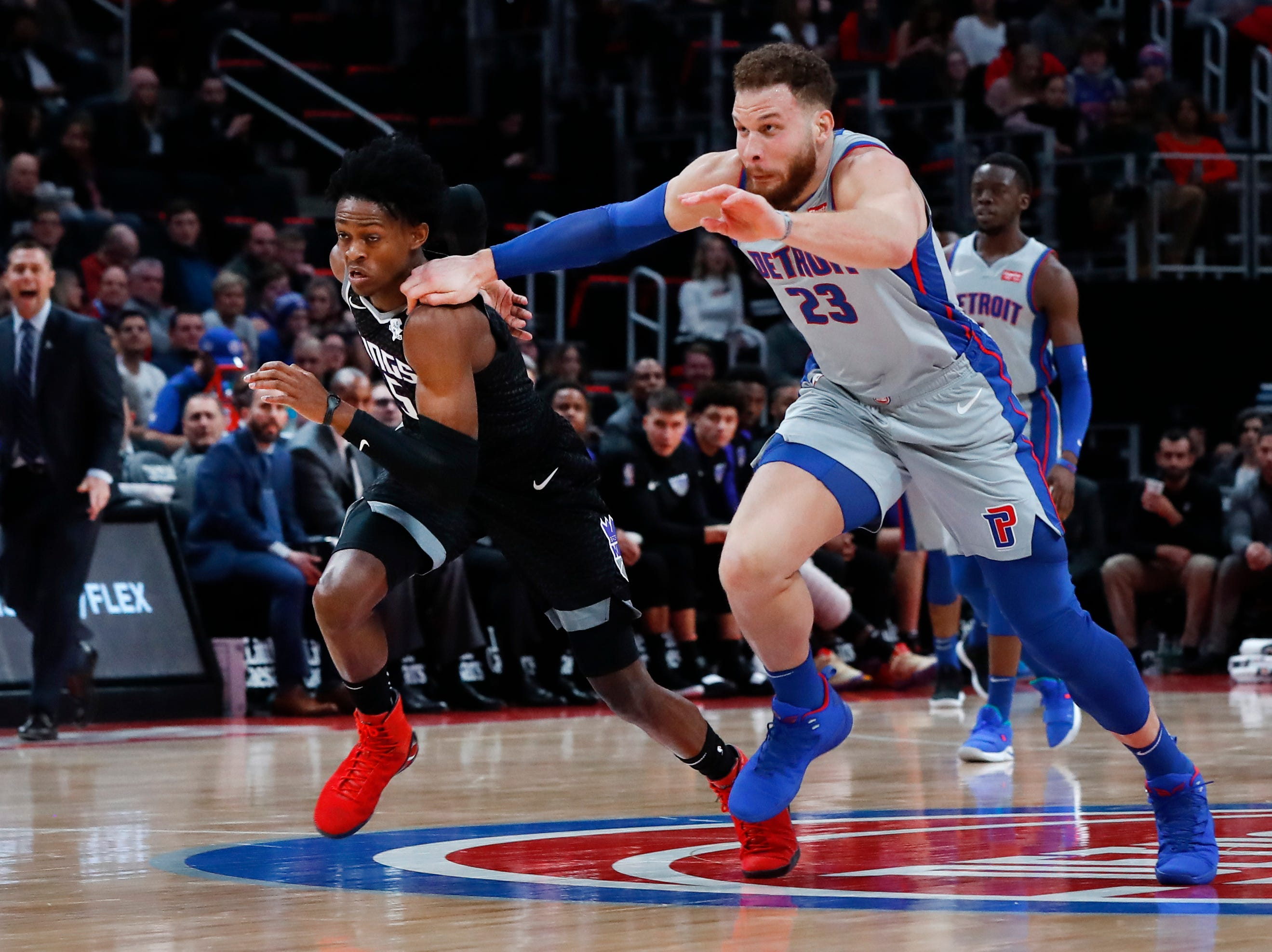 Detroit Pistons forward Blake Griffin (23) fouls Sacramento Kings guard De'Aaron Fox (5) while chasing a loose ball during the second half of an NBA basketball game in Detroit, Saturday, Jan. 19, 2019.