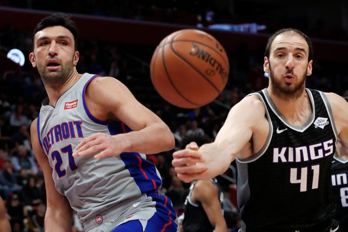 Detroit Pistons center Zaza Pachulia (27) and Sacramento Kings center Kosta Koufos (41) watch the ball during the first half of an NBA basketball game in Detroit, Saturday, Jan. 19, 2019.