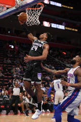 Sacramento Kings guard Buddy Hield (24) lays it up during the first quarter against the Detroit Pistons at Little Caesars Arena.