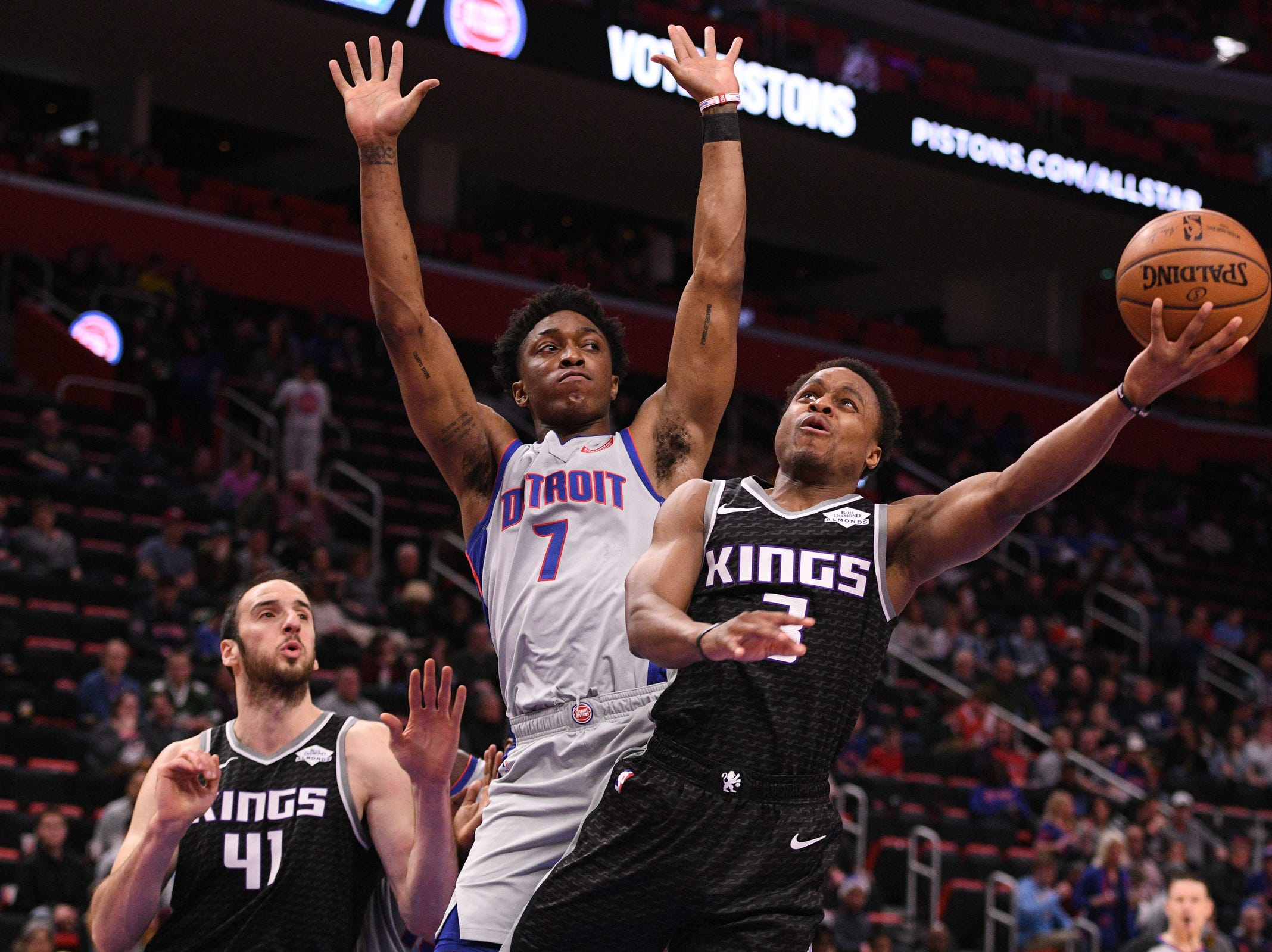 Sacramento Kings guard Yogi Ferrell (3) photos a layup defended by Detroit Pistons forward Stanley Johnson (7) at Little Caesars Arena.