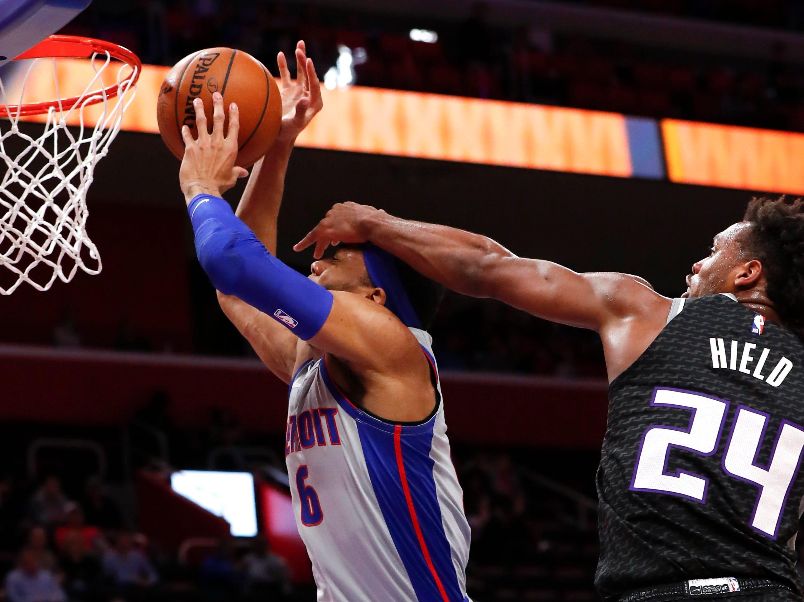 Sacramento Kings guard Buddy Hield (24) fouls Detroit Pistons guard Kalin Lucas (6) in the first half of an NBA basketball game in Detroit, Saturday, Jan. 19, 2019.