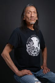 Native American advocate Nathan Phillips, of Ypsilanti, Michigan, sits for a portrait in Ypsilanti on May 2, 2015. Phillips gained national attention after a standoff between Phillips and a group of Catholic high school students went viral Jan. 18, 2019, in Washington, D.C.