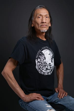 Native American advocate Nathan Phillips, of Ypsilanti, Mich., sits for a portrait in Ypsilanti on May 2, 2015. Phillips gained national attention following a standoff between Phillips and a group of Catholic high school students went viral on Friday, January 18, 2019 in Washington, D.C.