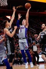 Detroit Pistons guard Luke Kennard (5) drives on Sacramento Kings guard Bogdan Bogdanovic (8) in the first half of an NBA basketball game in Detroit, Saturday, Jan. 19, 2019.