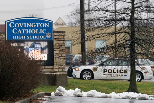 A police car sits at the entrance to Covington Catholic High School in Park Hills, Ky., Saturday, Jan 19, 2019.