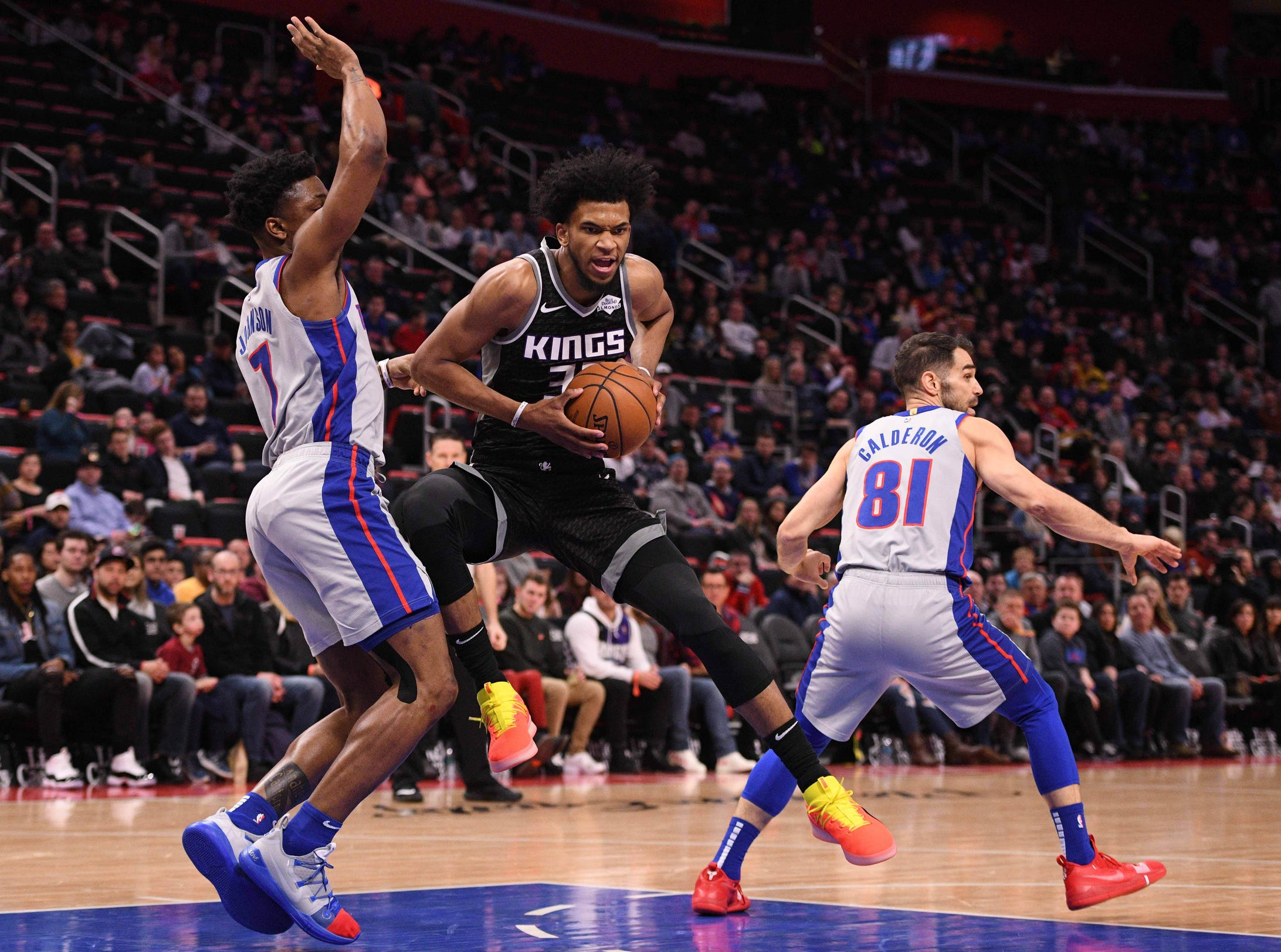 Sacramento Kings forward Marvin Bagley III (35) drives to the basket as Detroit Pistons forward Stanley Johnson (7) defends during the second quarter at Little Caesars Arena.