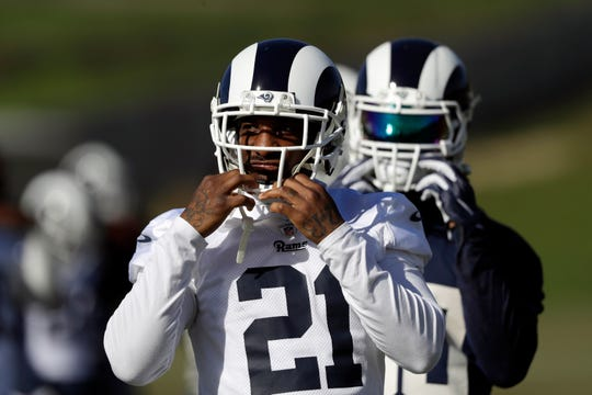 The Los Angeles Rams' Aqib Talib warms up during practice.