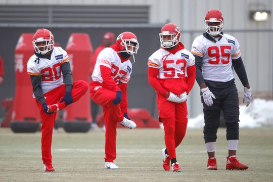 Kansas City Chiefs cornerback Steven Nelson (20), defensive back Orlando Scandrick (22), inside linebacker Anthony Hitchens (53) and defensive end Chris Jones (95) stretch during workouts.