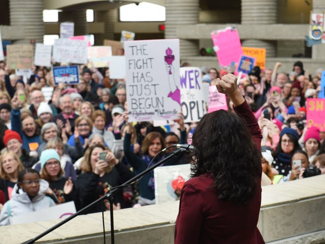 U.S. Rep. Rashida Tlaib, D-Detroit, raises her fist in solidarity as she speaks at the Women's March in Michigan inside thee Charles Wright Museum of African American History in Detroit last week.