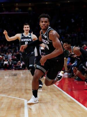 Sacramento Kings guard Buddy Hield celebrates hitting the game-winning 3-point basket against the Detroit Pistons.