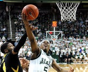 Michigan State point guard Cassius Winston is fifth in the Big Ten in scoring, first in assists and third in 3-point shooting.