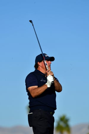Phil Mickelson of the United States looks on at the 17th hole during the third round.