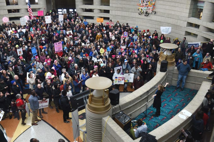 Michigan Secretary of State Jocelyn Benson (lower right) speaks to hundreds gathered at the Charles H. Wright Museum of African American History for the Women's March Michigan on Saturday, January 19, 2019.