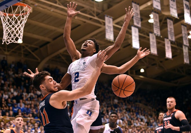 Virginia's Ty Jerome (11) fouls Duke's Cam Reddish (2) during the second half.