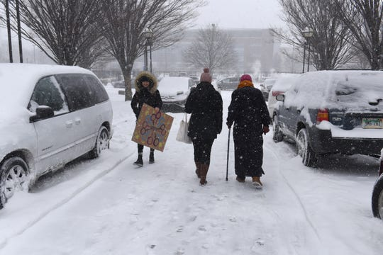 People braved for the cold and snow on Saturday outside the Charles H. Wright Museum of African American History. The National Weather Service says Sundaay the temperature hovered around 7 degrees, a day after several Saturday brought inches of snow and a cold front hit the region.