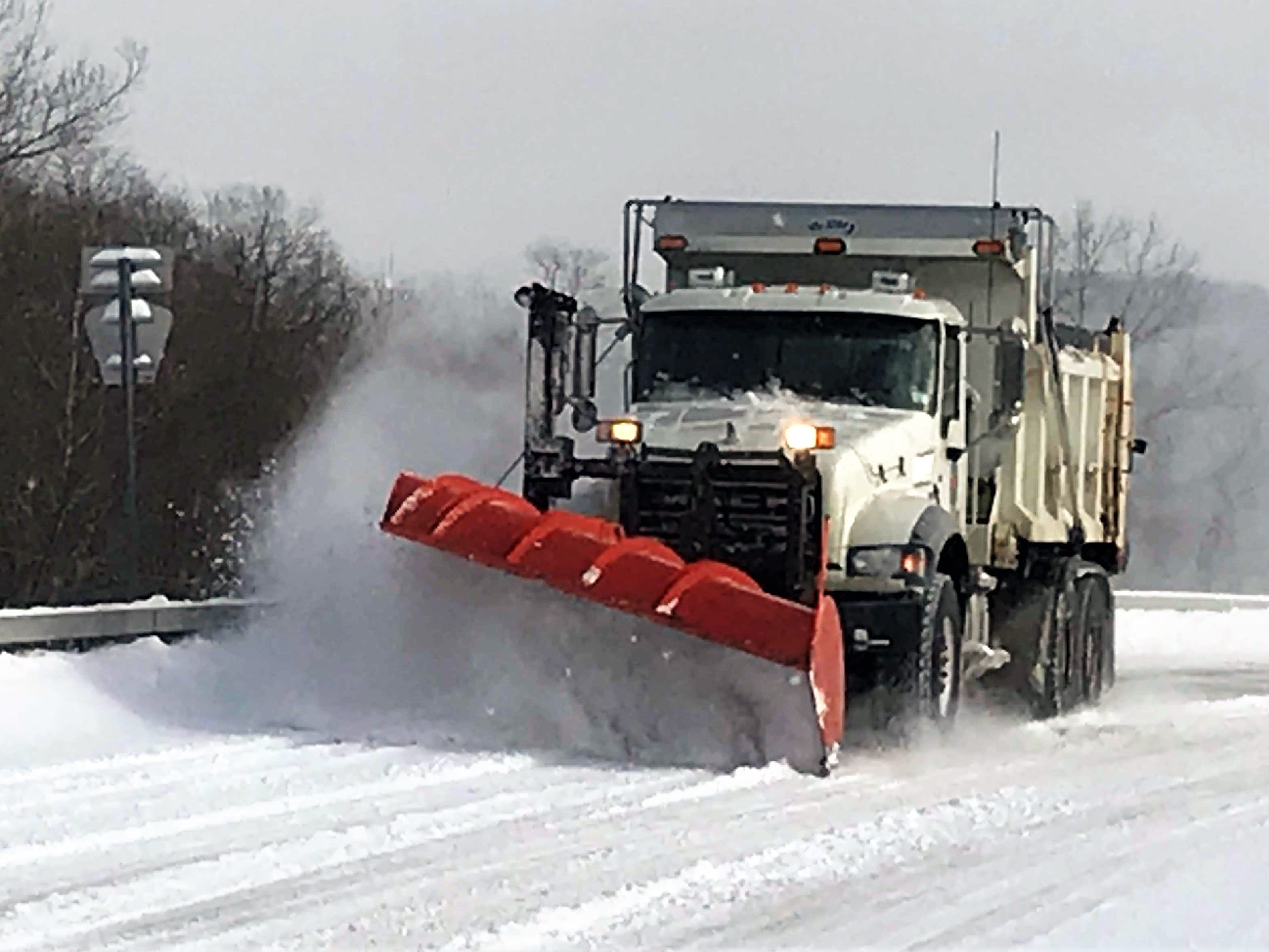 A Chemung County plow clears snow from county Route 60 in the Town of Chemung on Sunday morning.