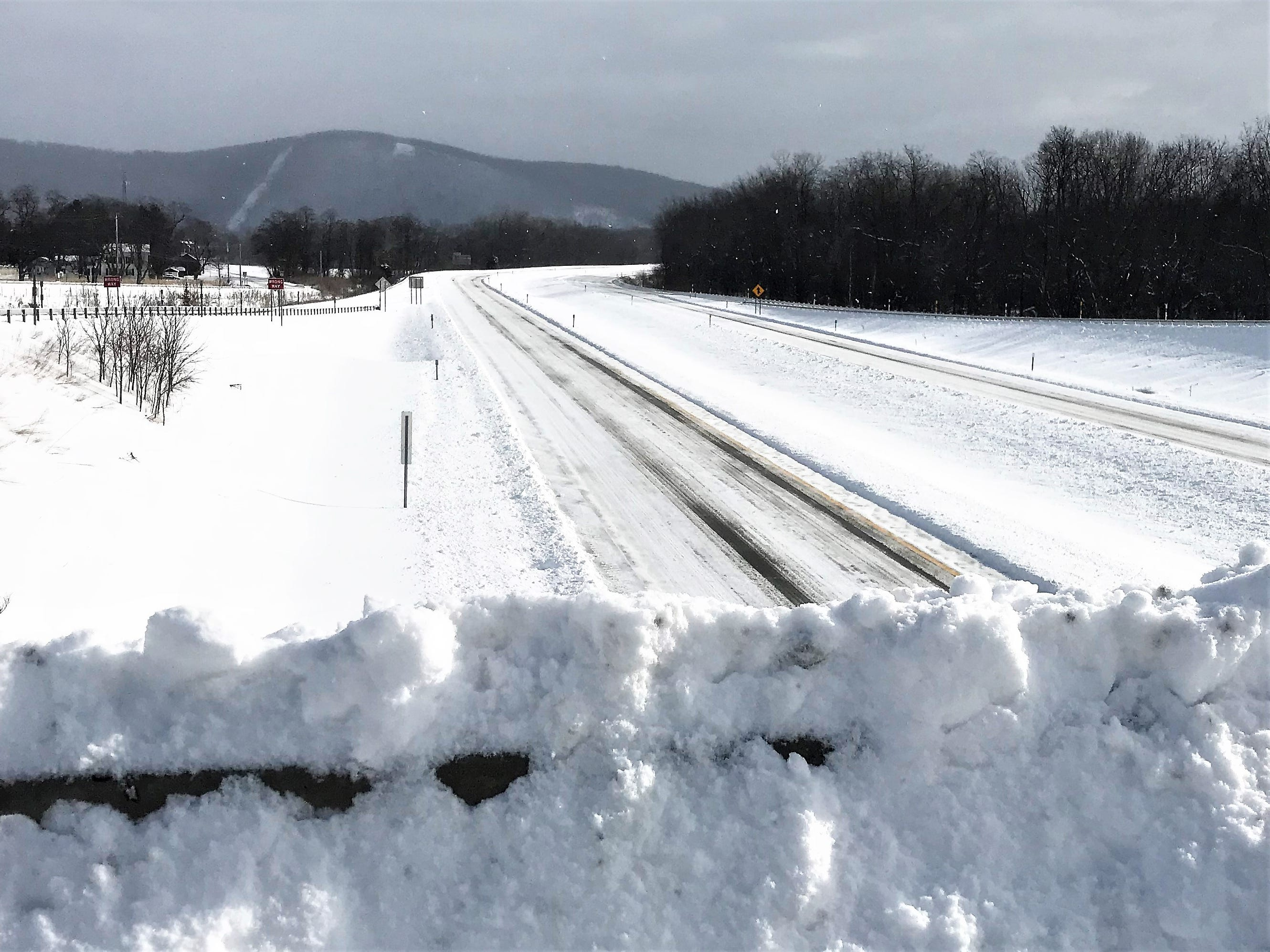 Interstate 86 through eastern Chemung County is almost clear of snow but nearly deserted Sunday morning.