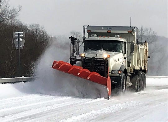 A Chemung County snowplow clears snow from county Route 60 in the Town of Chemung on Sunday morning.