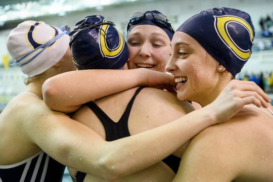 Kaitlyn Porter  Alex Hurlock, Hannah Haerle and Jamie Zimmerman embrace as they react to winning the girls 400 yard free relay during the SIAC swimming tournament at Castle High School in Newburgh, Ind., Saturday, Jan. 19, 2019. Castle won the tournament with a final score of 503 points.