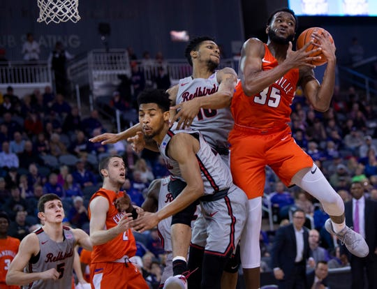 Evansville's John Hall (35) pulls down a rebound against Illinois State at the Ford Center Saturday afternoon, Jan. 19, 2019.