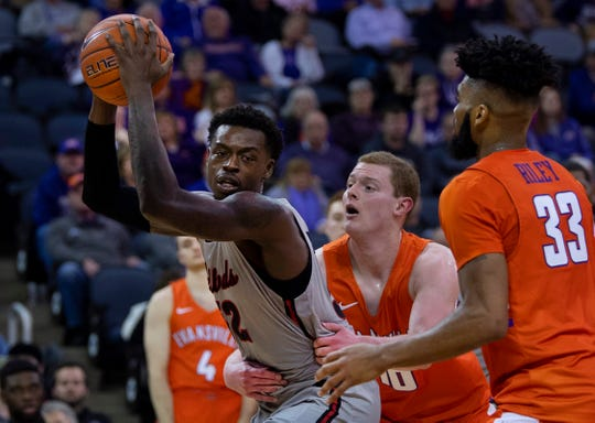 Illinois State's Milk Yarbrough (52) is fouled by Evansville's Evan Kuhlman (10) at the Ford Center Saturday afternoon, Jan. 19, 2019.